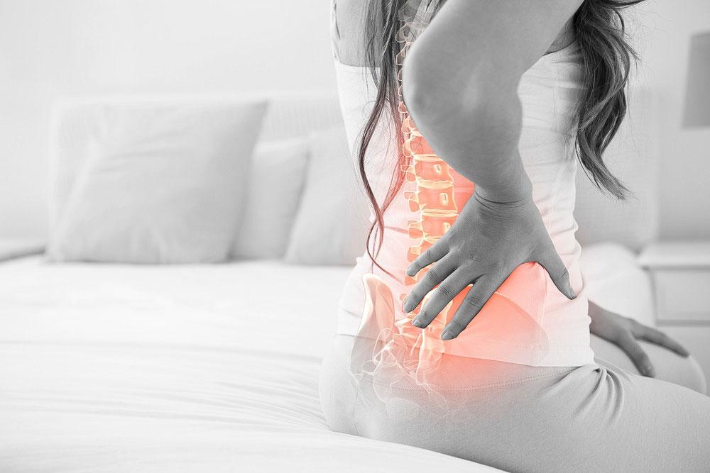 female-back-pain-osteopath